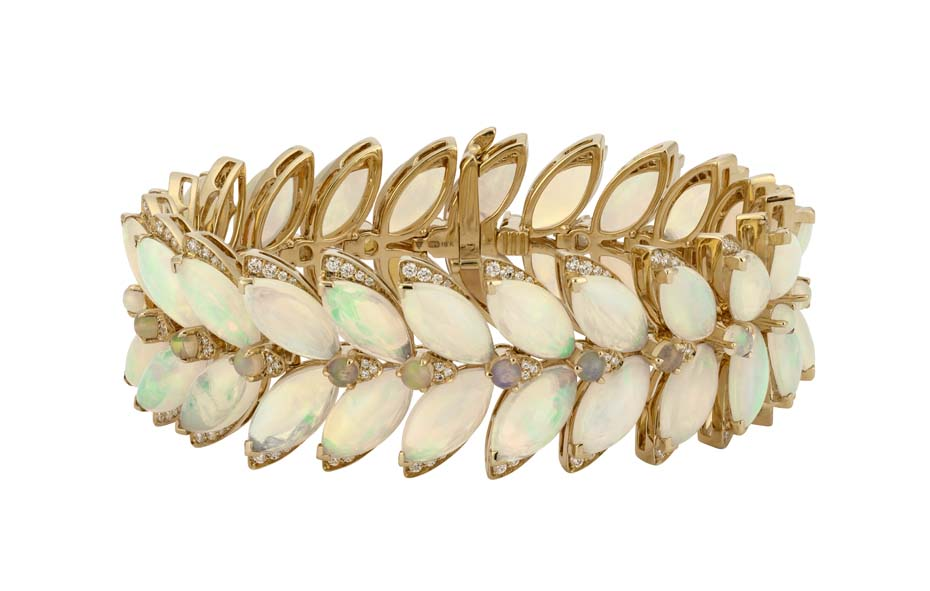 Opals_April stone of month_Stephen Webster_Magniphe Feathers bracelet set in 18ct yellow gold opal and white diamonds.jpg
