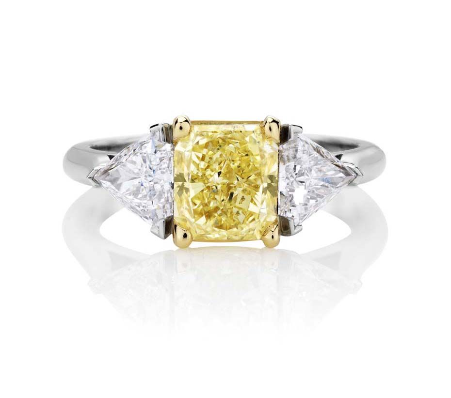 Three stone engagement rings_De Beers S Shank ring.jpg